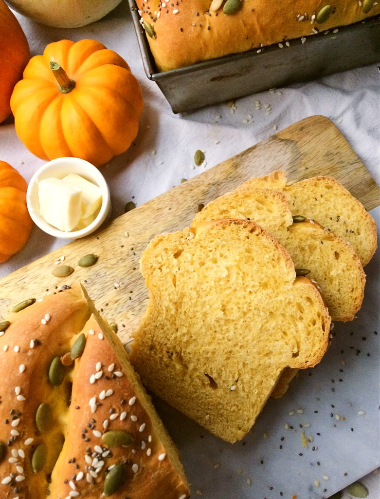Try this delicious made from scratch savoury pumpkin bread as a sandwich bread, as toast, or made into dinner rolls.  It's an easy healthy recipe made with yeast that your family, and even your kids, is sure to love. #pumpkin #bread #recipe #easy #healthy #dinnerrolls #baking #fall #autumn #fromscratch #Thanksgiving