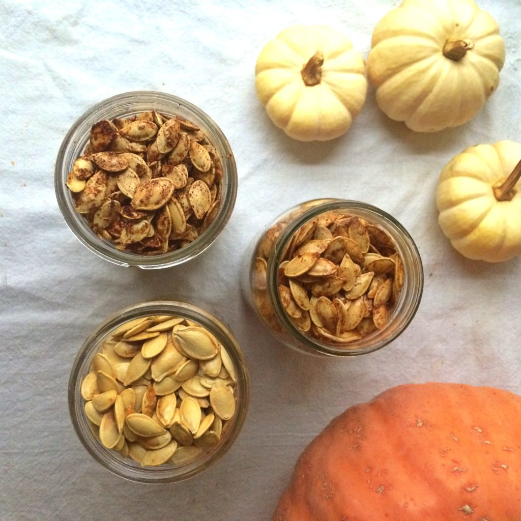 Wondering how to make roasted pumpkin seeds?  I'll show you how to cook raw pumpkin seeds into a delicious, healthy, oven-baked snack. Three easy flavour recipes to try! #pumpkin #pumpkinseeds #snack #healthy #pumpkinseeds #roasted #baked #recipe