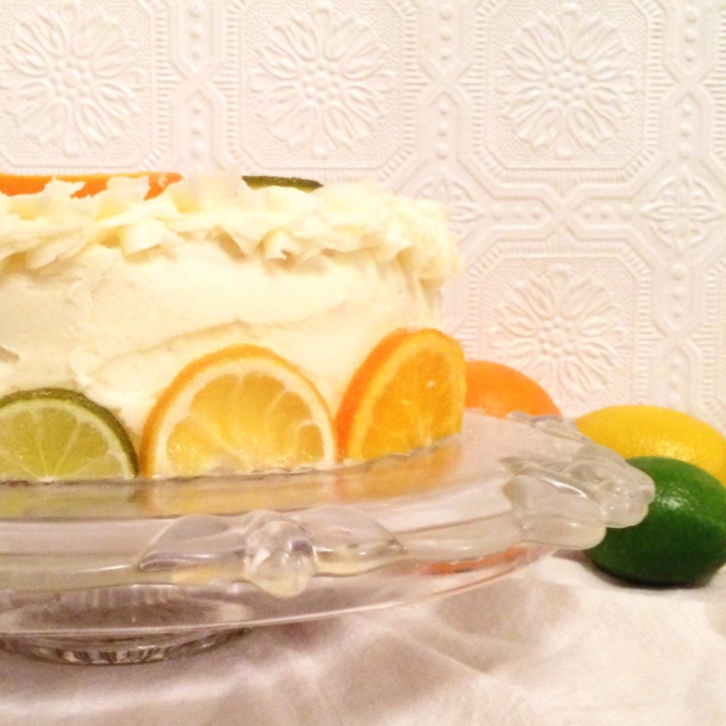 lemon cake with candied citrus and lemon buttercream frosting