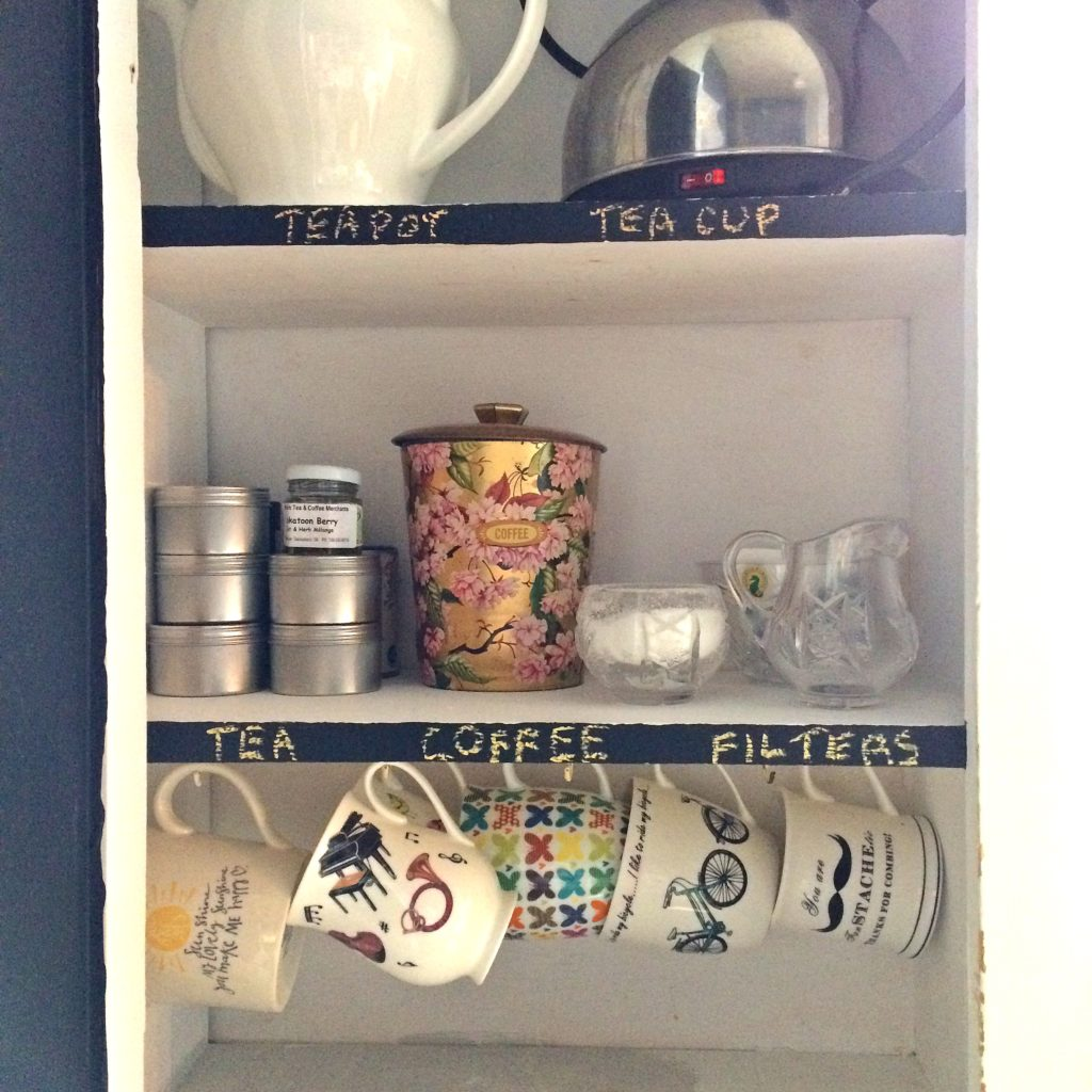A peaceful, decluttered coffee cupboard.