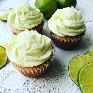 Coconut cupcakes with lime buttercream frosting.