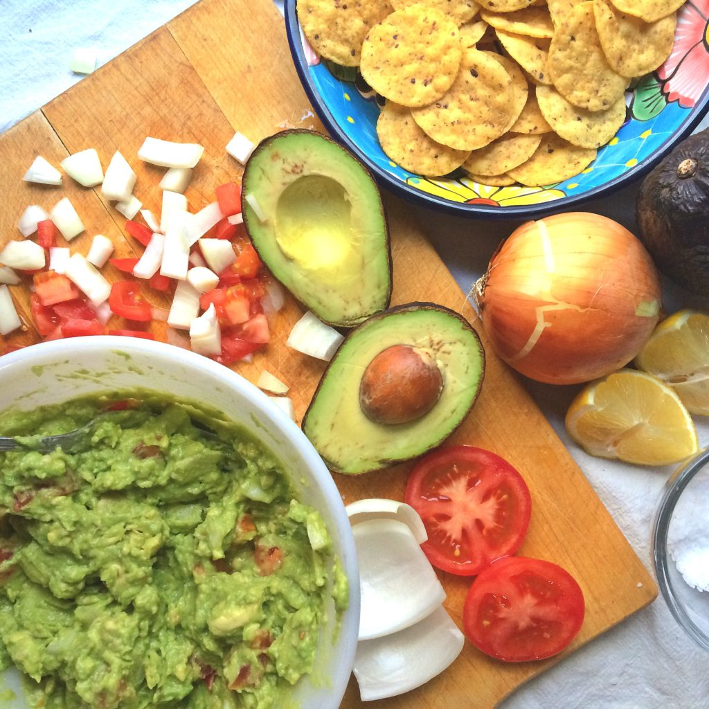 It's Mexican night and you need the perfect guacamole. Loads of healthy avocados, tomatoes, onions, lime, garlic and no cilantro. Try this easy and simple homemade guacamole in your tacos and burritos and you'll be glad you did! #guacamole #mexicannight #mexicanfood #tacotuesday #taconight #avocado #easyguacamole