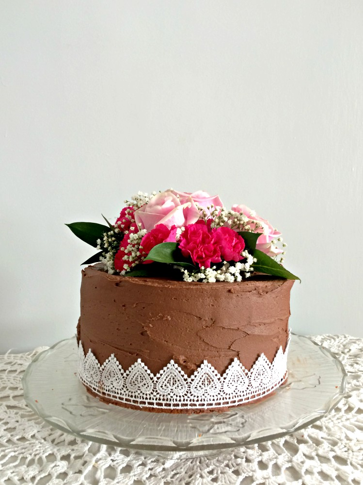 You, yes you, can easily make this gorgeous wedding cake with pink roses, carnations, and baby's breath. A DIY that will actually save you money.