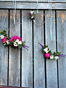 Floral hoops perfect for a wedding shower or outdoor wedding.