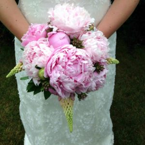 Wedding flowers for a beautiful bride using stunning pink peonies.