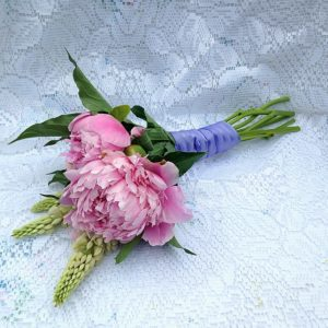 Sweet and elegant bridesmaid bouquet with beautiful pink peonies