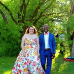 Gorgeous inspiration for your casual backyard wedding reception. Check out the bride's sweet wedding dress with a bright floral pattern. Don't they look stunning? I love the groom's navy suit with coral accents.