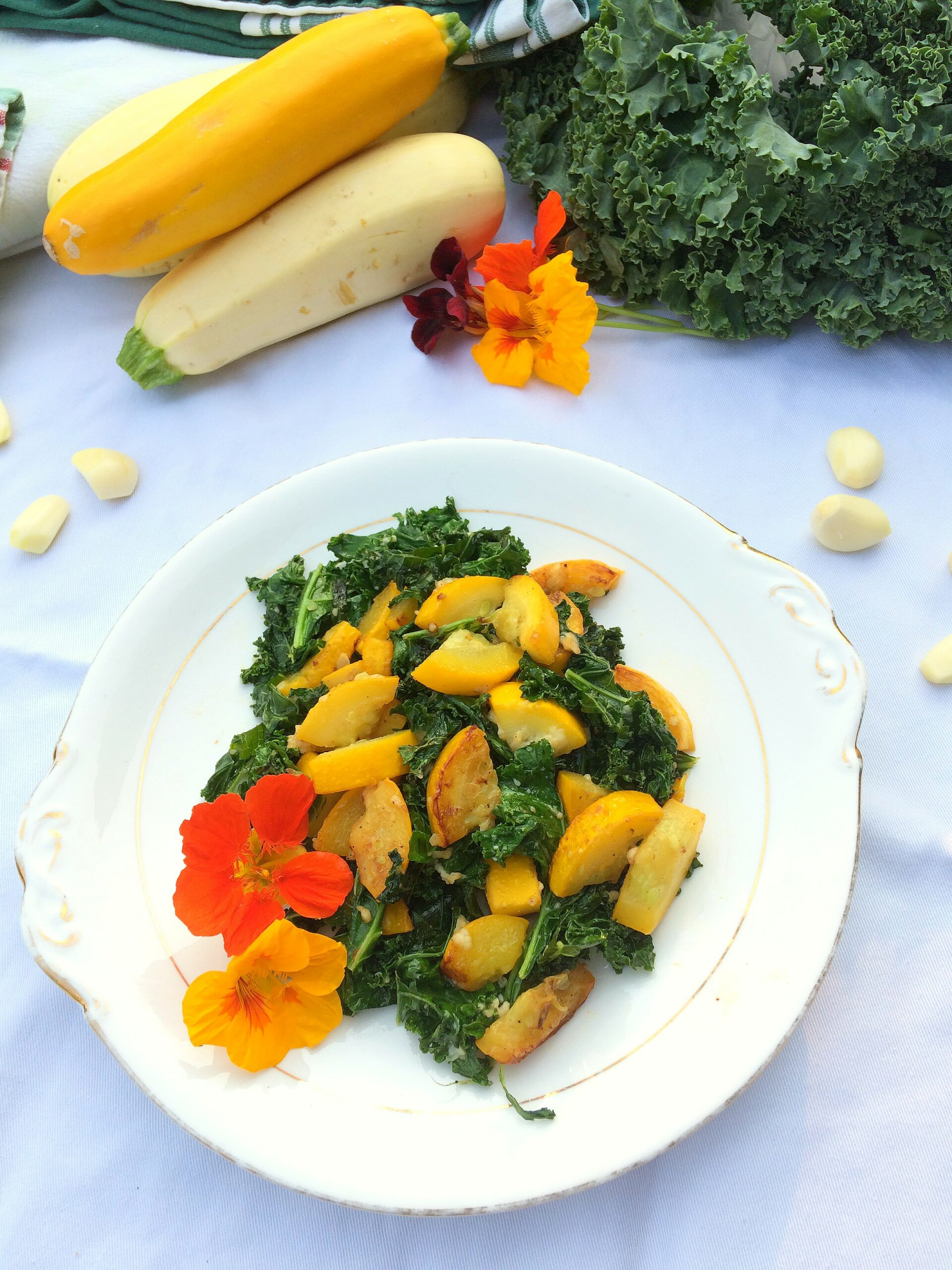 An easy summer side dish recipe to use up your garden produce.  Tender zucchini and crisp kale shine when fried and paired with garlic and parmesan.  So good even your zucchini-hating friends will like it.  Sub in summer squash for a tasty alternative!