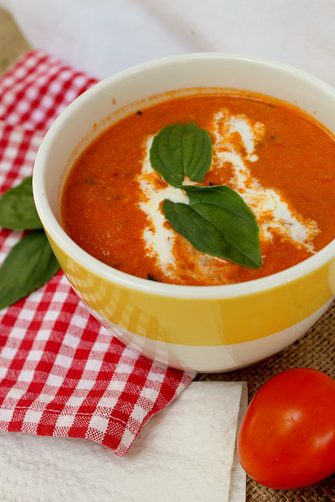 Harvest season means a surplus of tomatoes.  My favourite way to use them is this creamy roasted tomato soup.  Chock full of tomatoes, zucchini, peppers, carrots, onions, garlic, and basil, it's an easy and healthy recipe you'll want to make again and again.