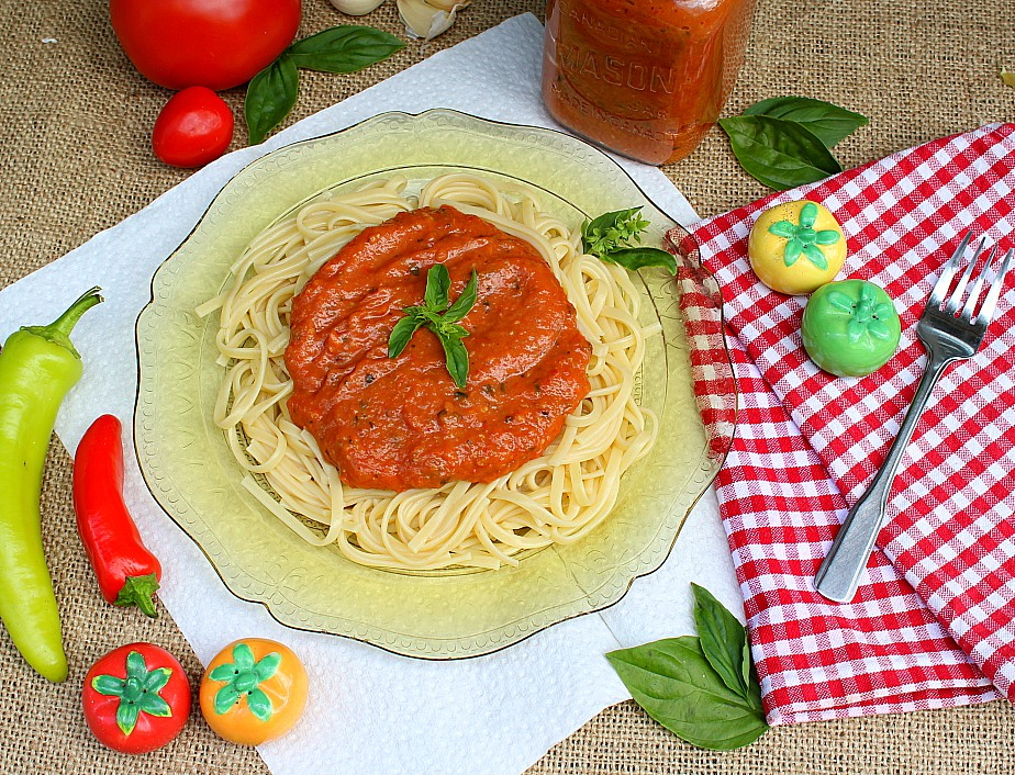 So many tomatoes and so little time! My favourite way to use garden fresh tomatoes is this homemade roasted tomato sauce. It's an easy pasta sauce recipe with fresh basil that your family will love.