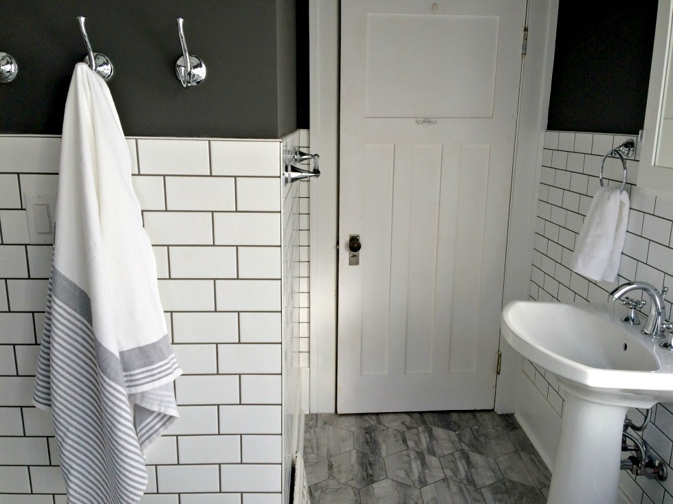 Our small bathroom renovation before and after is finally here! It's farmhouse style with lots of soothing grey and white. The best part? The pedestal sink and freestanding tub! #whitebathroom #smallbathroom #bathroomremodel #bathroombeforeandafter #whiteandgreybathroom #hexagontiles #farmhousestylebathroom #freestandingtub
