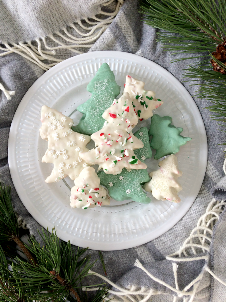Give your holiday baking a little extra cheer with these white chocolate covered Rice Krispie Christmas Trees. Simple and easy to make as gifts or to add to your Christmas baking tray. But be warned, everyone will be asking for the recipe! #christmas #holiday #baking #ricekrispie #ricekrispietreat #christmasbaking #holidaybaking #easy #recipe #dessert #kids #gift #diygift #whitechocolate