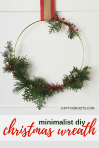 Christmas is expensive and I need decorations at dollar store prices!! This DIY Christmas wreath is rustic, minimal, and would look so good in my home decor. It's easy to make with a hoop, some greenery, ribbon, and a little know how. #christmasdecor #christmaswreath #holiday #rusticchristmas #minimalchristmas