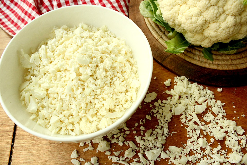 Ever wondered how to make cauliflower rice? Here's an easy healthy recipe to replace rice or pasta. It's low carb, vegetarian, paleo, whole 30, or keto friendly. So simple and delicious! I know I'll be planting more cauliflower in my vegetable garden this year just so I can make more of this! #cauliflowerrecipe #cauliflowerrice #lowcarb #keto #one3one #vegetarian #paleo #glutenfree #healthyrecipe #healthy #lunch #dinner #supper