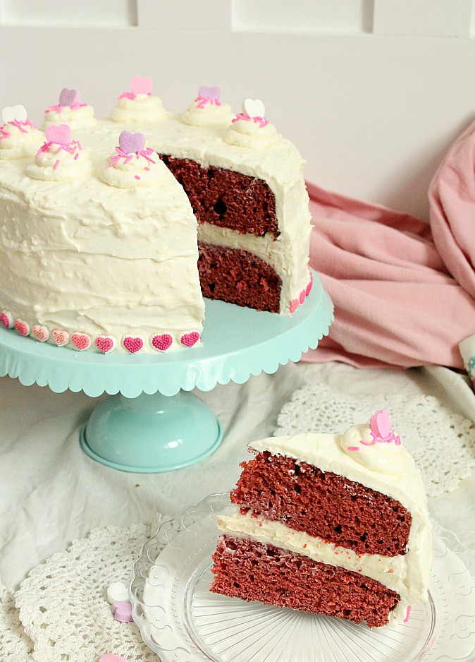 Looking for a the Goldilocks of Red Velvet cakes with cream cheese frosting?  This one is made with beets, very little food colouring, and without buttermilk.  It's an easy, from scratch recipe that's perfect for your Valentines day baking. #redvelvetcake #creamcheesefrosting #beets #fancycake #Valentinesday #baking #valentinesbaking #bakingwithbeets #bakingwithvegetables
