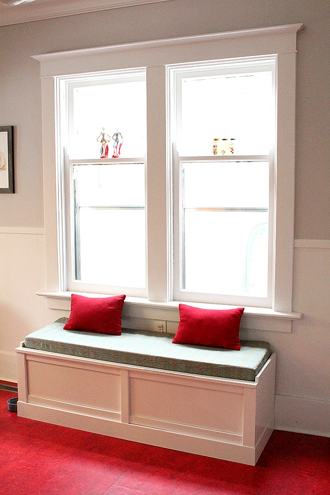 A cute red and turquoise banquette with extra storage hidden inside. #banquette #red #turquoise #storagesolutions