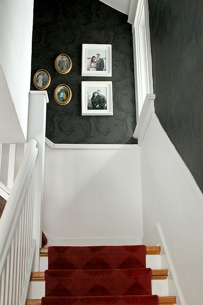 Wouldn't you love to come home to this black and white stairway, with stunning red carpet stair runner? I really want that black textured wallpaper! #wallpaper #stairrunner #red #black #white #staircase