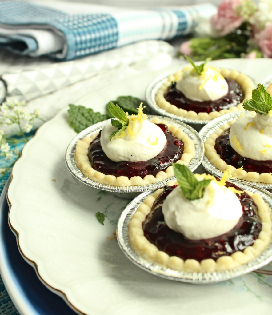 If you grow haskap plants, you need this haskap berry recipe for an easy summer desert.  The tarts are made with pie filling that could easily be cooked longer to make a jam. #haskap #honeyberry #summerdessert #tartrecipe #piefilling