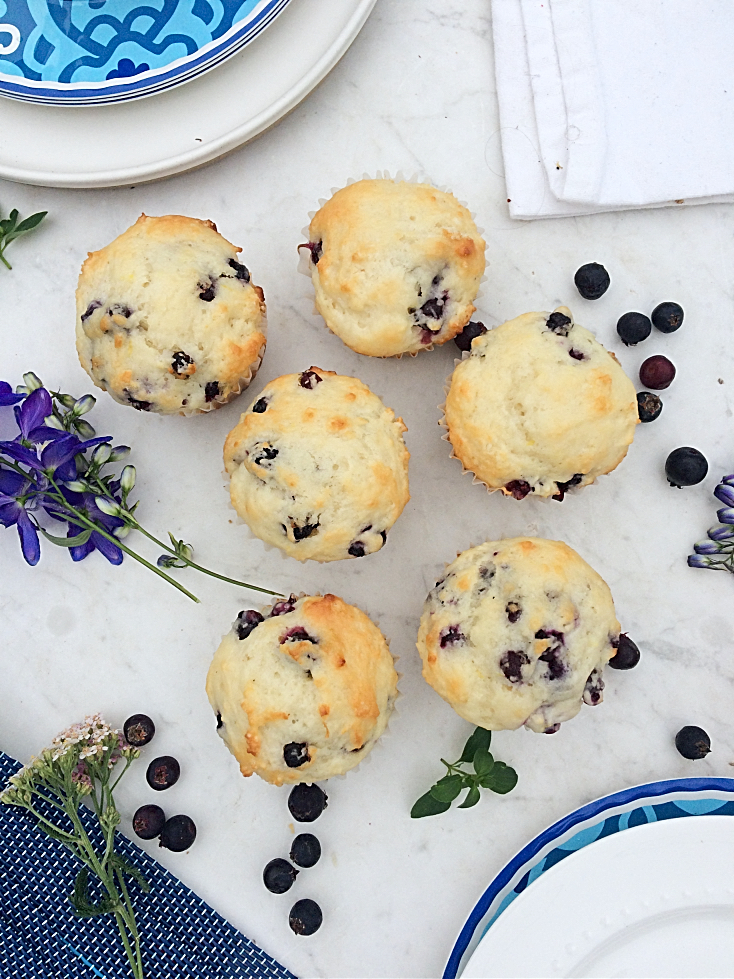 Saskatoon berry muffins make for a healthy after school snack.  You'll love this easy dessert recipe with hints of lemon.  Substitute blueberries if you can't find Saskatoon berries. #muffinrecipes #saskatoonberries #afterschoolsnacks #healthysnacks #blueberries