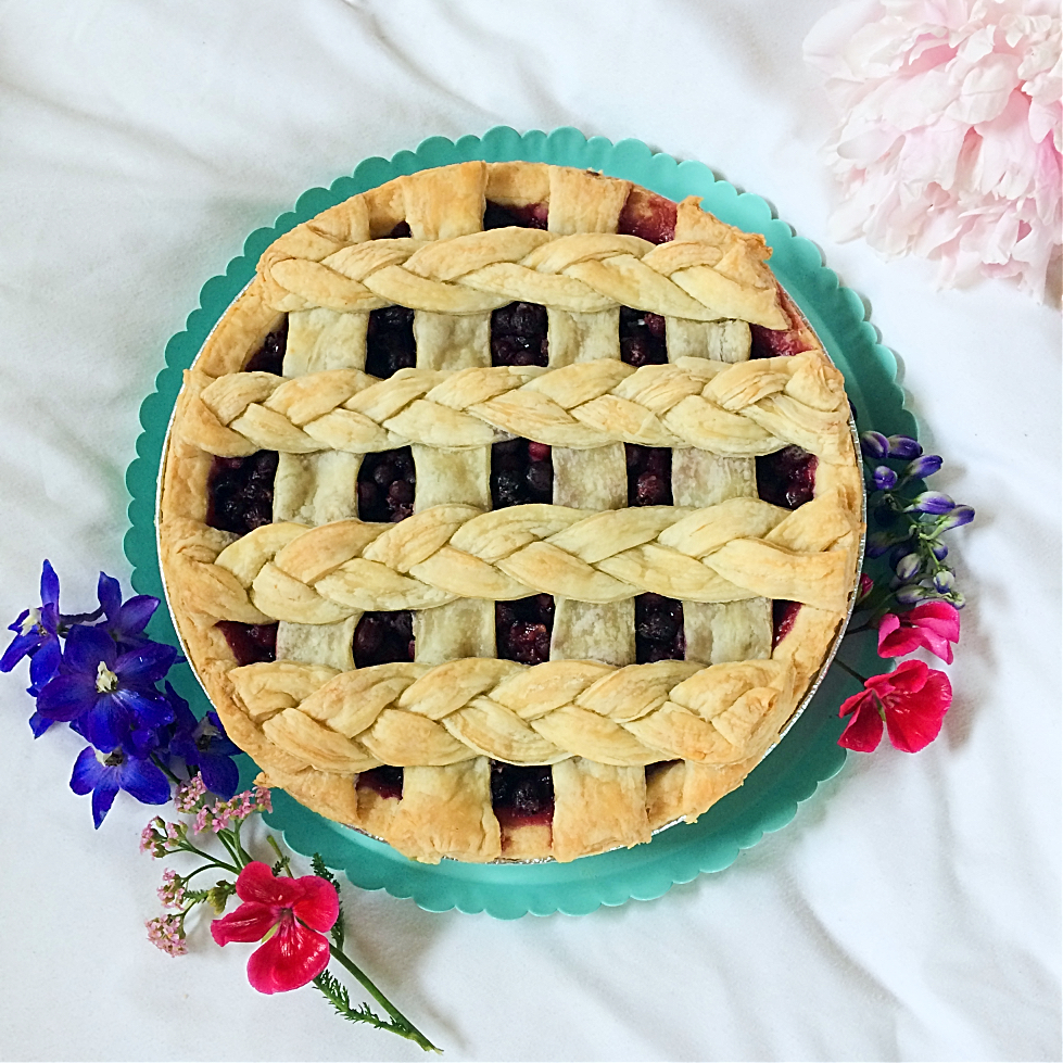 It just isn't summer without a slice of Saskatoon berry pie! This easy dessert recipe has a traditional crust, loads of saskatoon berries (or blueberries) filling, and just a hint of lemon. #saskatoonberries #pie #pierecipe #easydessert #summerdessert #berryrecipe #hardyfruits