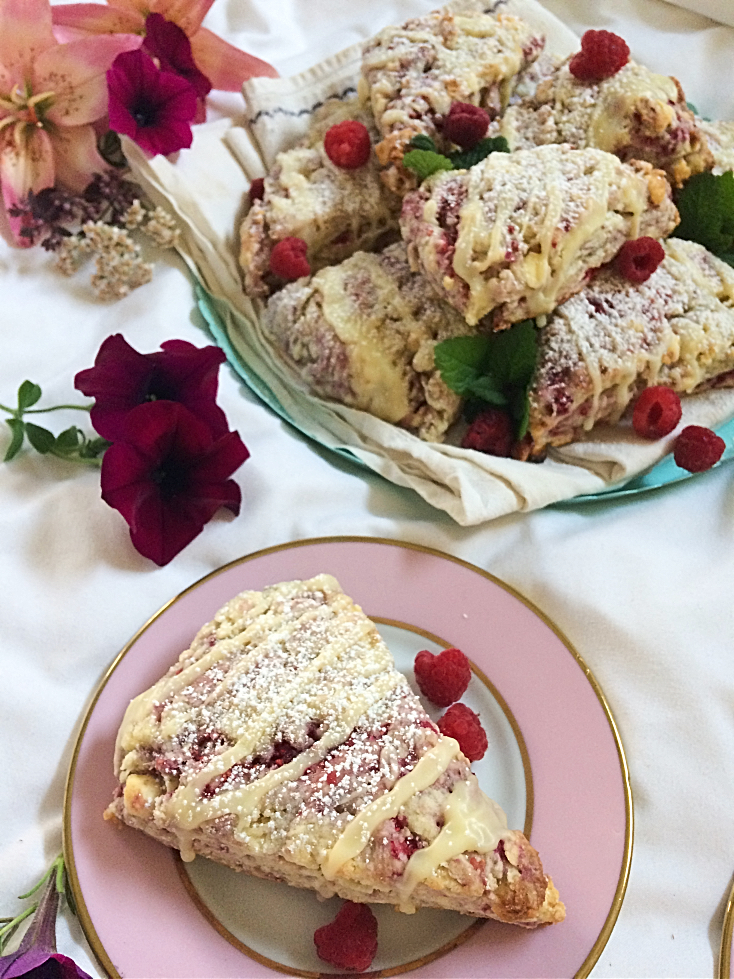 Seriously, you need these raspberry white chocolate scones in your life.  They're an easy and simple summer dessert recipe that is perfect for breakfast, dessert, or as a snack. #raspberry #whitechocolate #scone #sconerecipe #dessert #baking