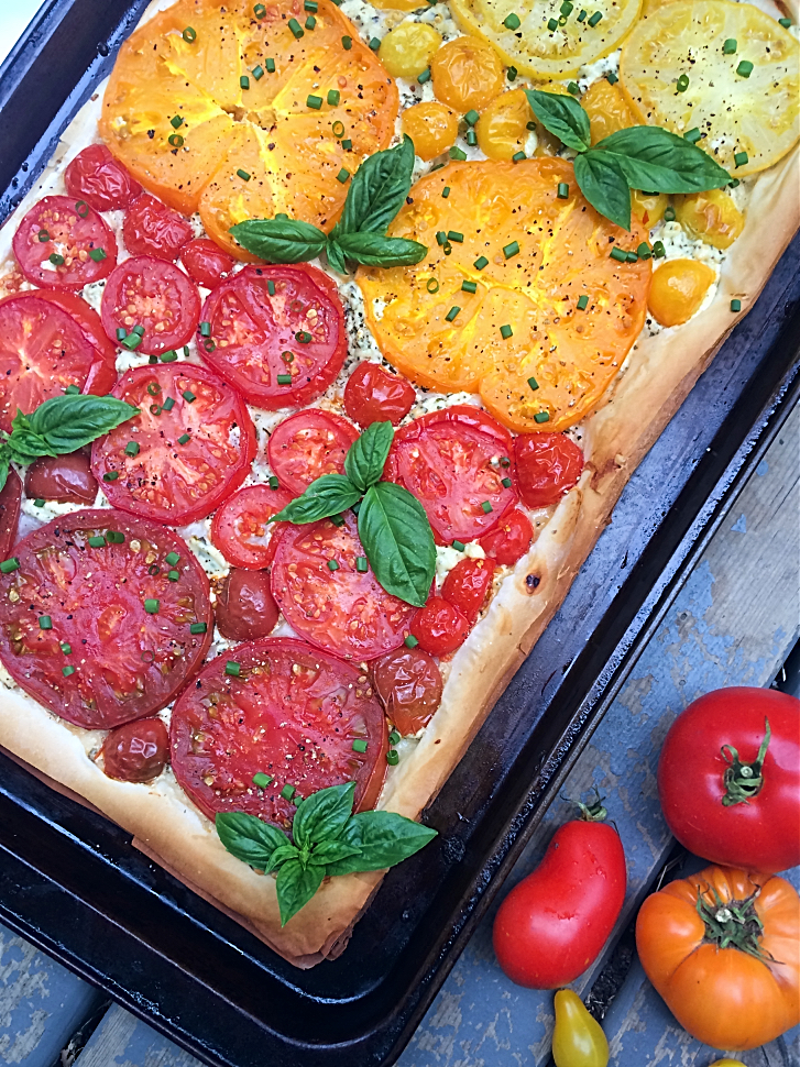 You will love this quick and easy appetizer that uses phyllo pastry, boursin cheese, basil, and garden fresh tomatoes--mostly heirloom!  Perfect for entertaining, holiday parties, and the vegetarians in the crowd.  #tomato #garden #recipe #appetizer #entertaining #tart