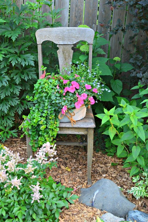I think whimsical garden art really makes a backyard flower bed.  I love these 20 diy ideas that are either recylcled, upcylcled, or from junk that nobody wants.  I need to do some of these in my outdoor space--this old chair project would be so easy. #gardenart #whimsical #flowergarden #landscapingideas