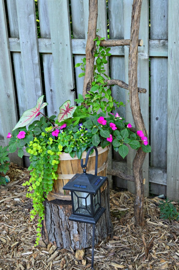 I think whimsical garden art really makes a backyard flower bed.  I love these 20 diy ideas that are either recylcled, upcylcled, or from junk that nobody wants.  I need to do some of these in my outdoor space--I love the ladder out of sticks. #gardenart #whimsical #flowergarden #landscapingideas